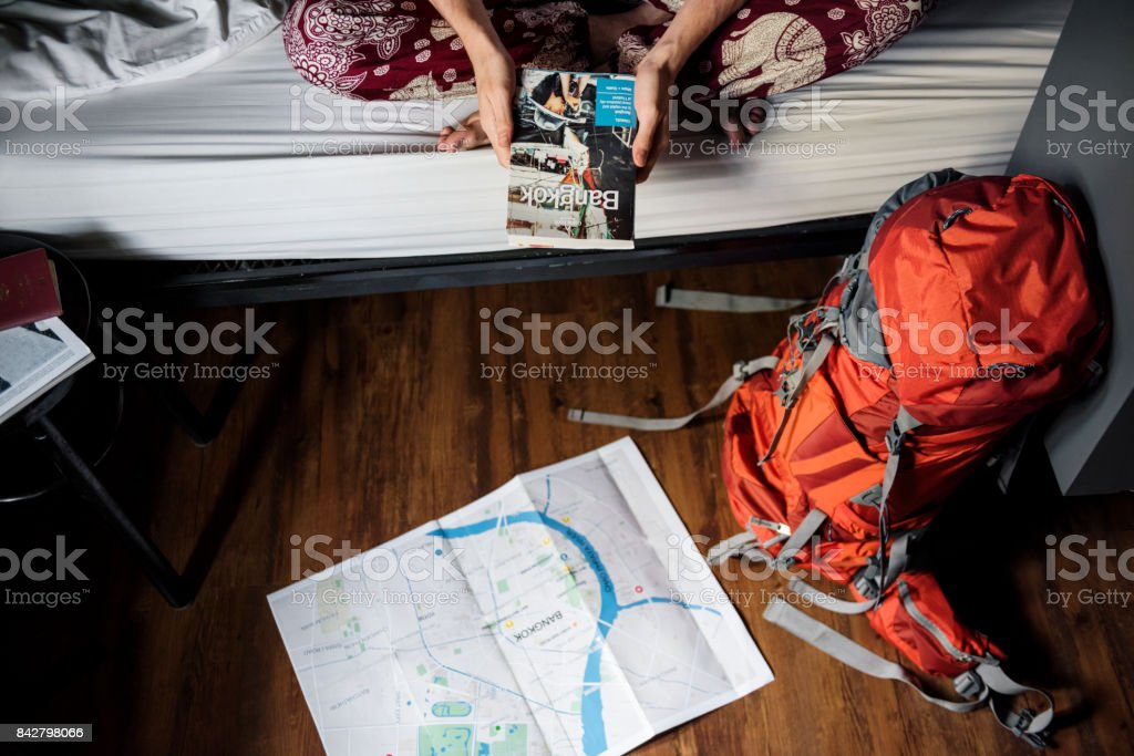 Young backpacker at hostel stock photo