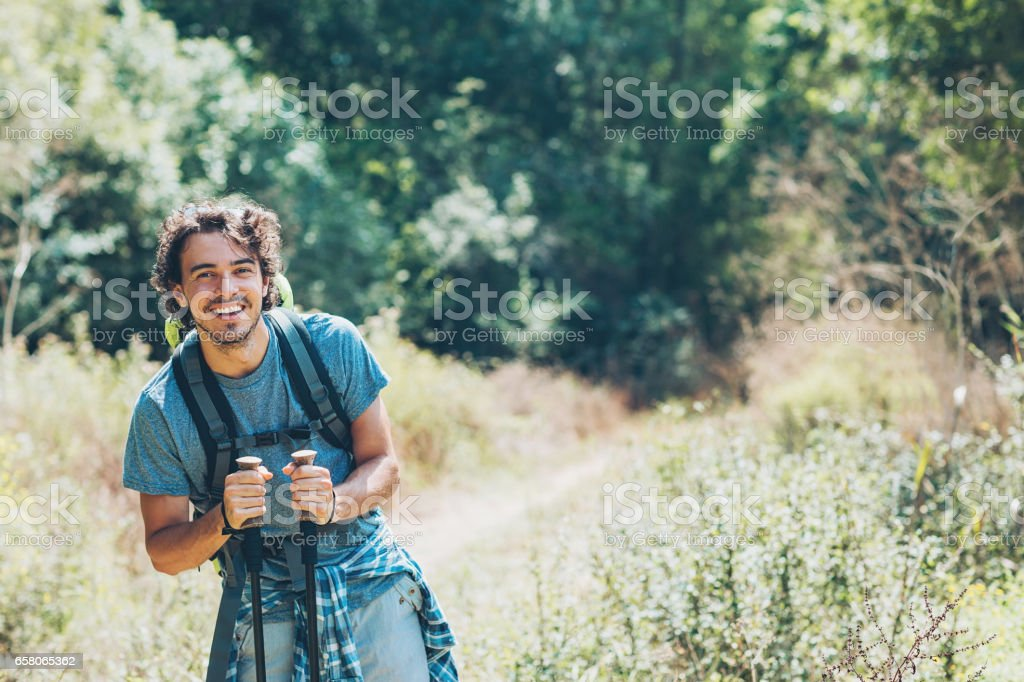 Young backpacker exploring the mountain royalty-free stock photo
