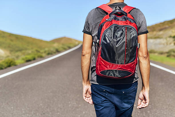 young backpacker man stock photo