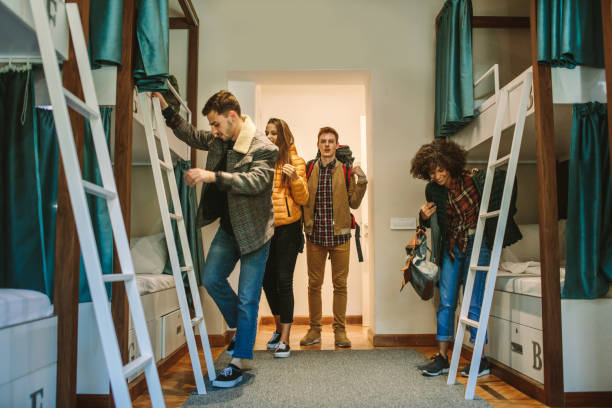 Young Backpackers In Hostel stock photo