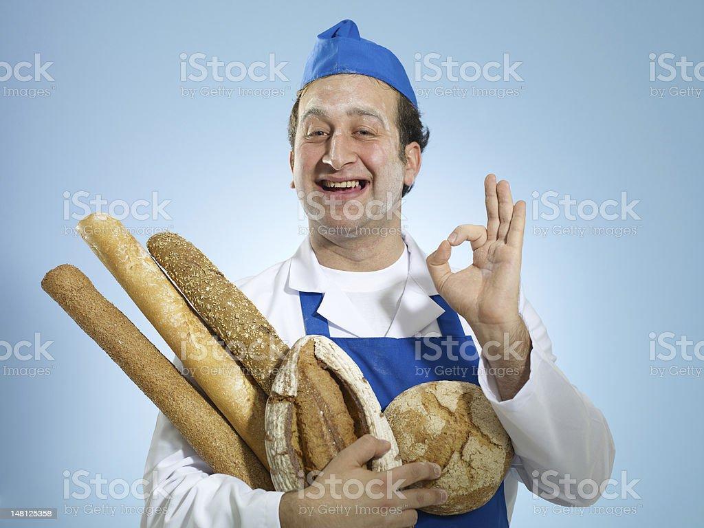 Jeune boulanger faisant signe A-Okay - Photo