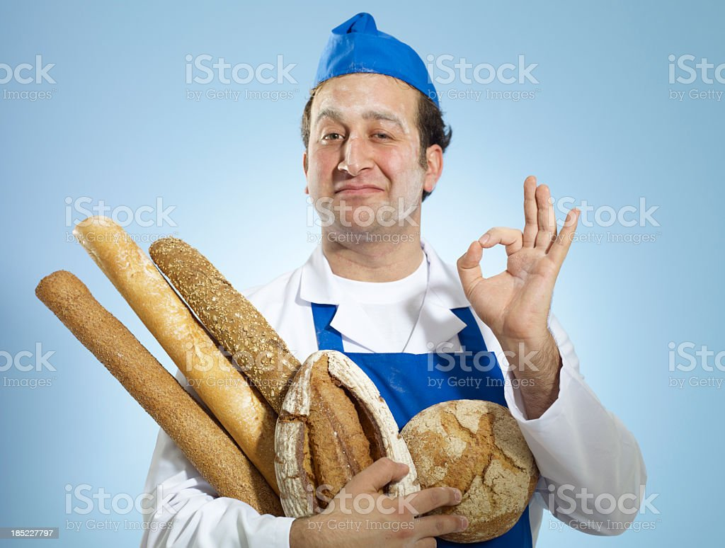 Young Baker Doing A-Okay Hand Signal stock photo
