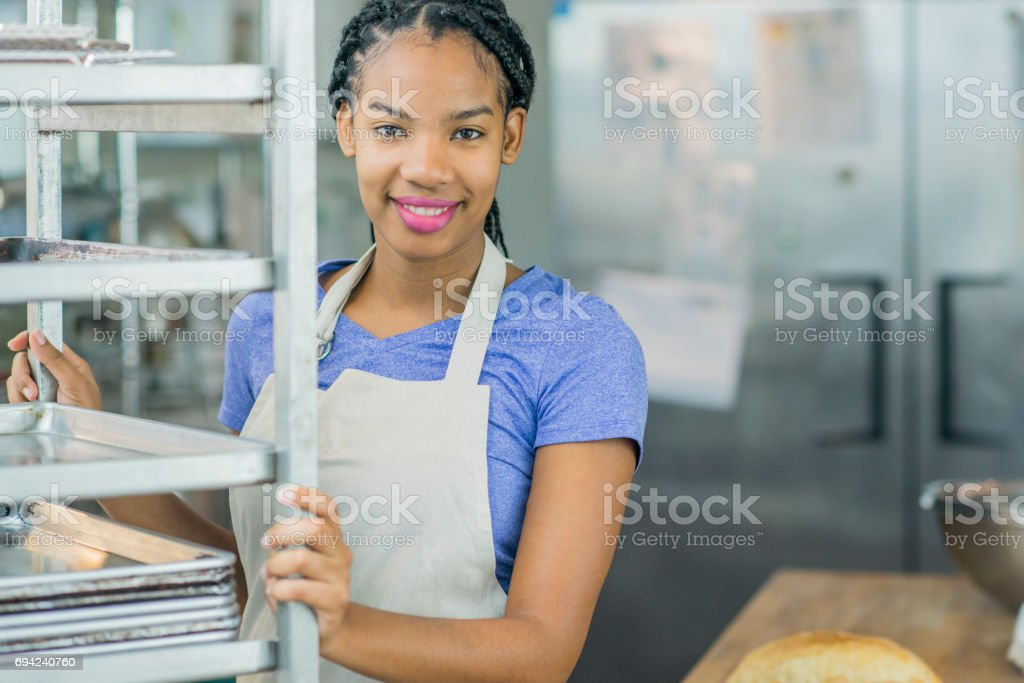 Young Baker in a Bakery stock photo
