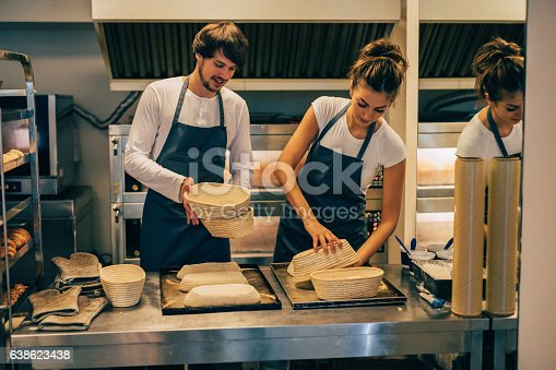 628876250 istock photo Young bakers making bread 638623438