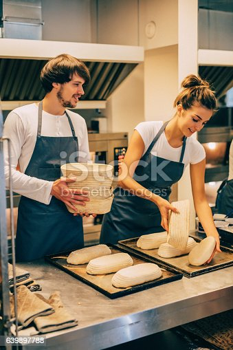 628876250 istock photo Young bakers making bread 639897788