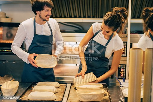 628876250 istock photo Young bakers making bread 640200866