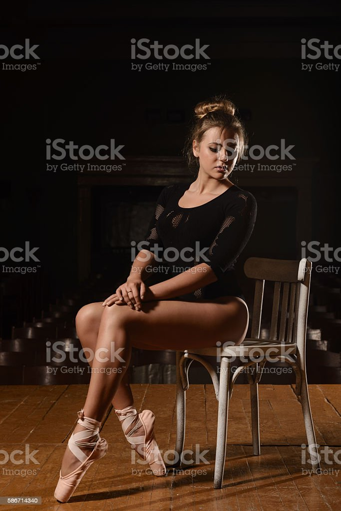 Young ballerina in theater posing, in costume, dancing stock photo