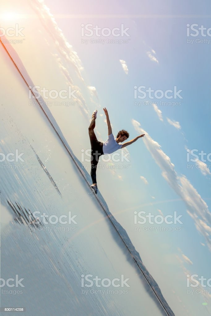 young ballet dancing on the lake in the evening stock photo