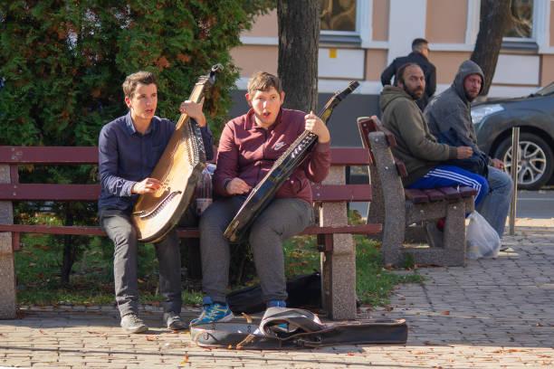 Cтоковое фото Kiev, Ukraine - October 14, 2018: Young bandura players play on city street