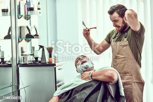 Young Barber Makes Mistake And Cuts Customer While Shaving
