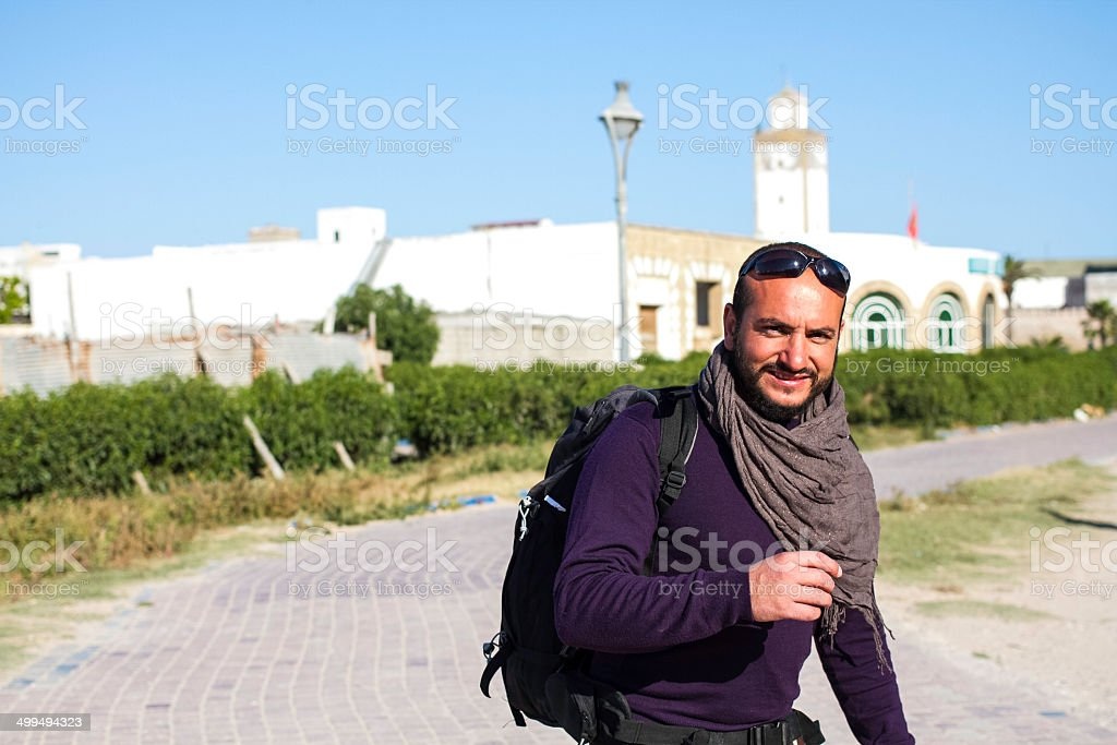 Young bared man with a backpack. Backpacker and traveller. stock photo