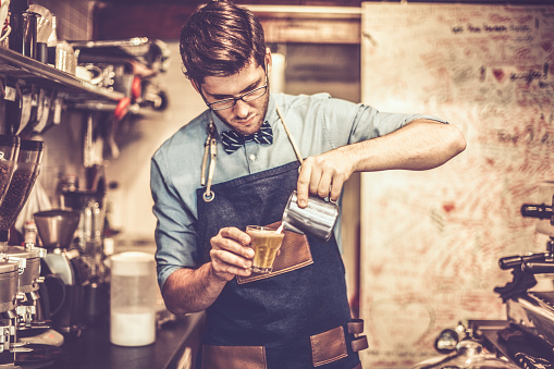 Young Barista Is Making A Coffee Stock Photo - Download Image Now