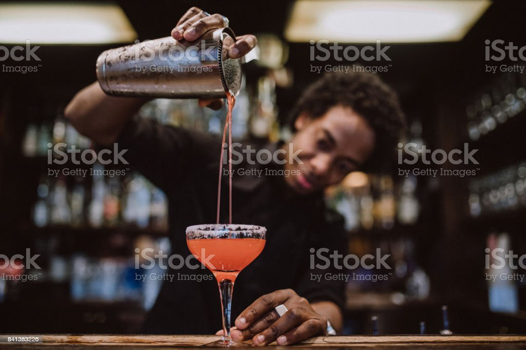 Young barista making coctails stock photo