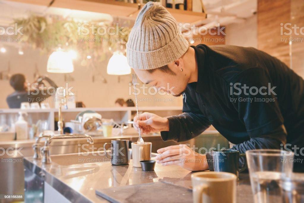 Young barista making latte art stock photo