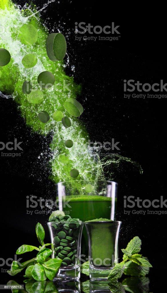 Young barley and chlorella spirulina stock photo