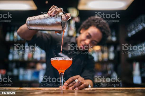 Young bartender pouring cocktails in a cocktail bar picture id880565298?b=1&k=6&m=880565298&s=612x612&h=gnbwtv4f6dpi5clrwlcnjxg3k9dhcyh kd vozpzyia=