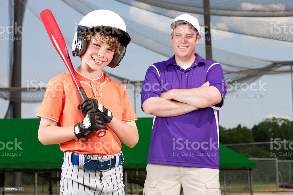 Young Baseball Player and Proud Father stock photo
