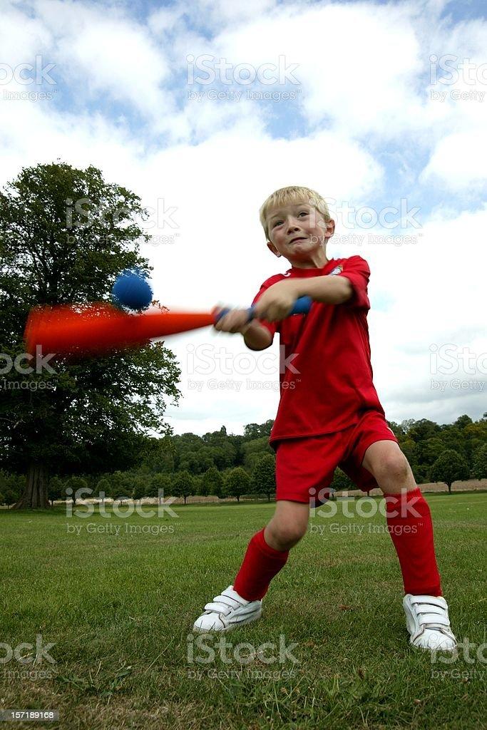 Young Baseball Player hitting home run stock photo