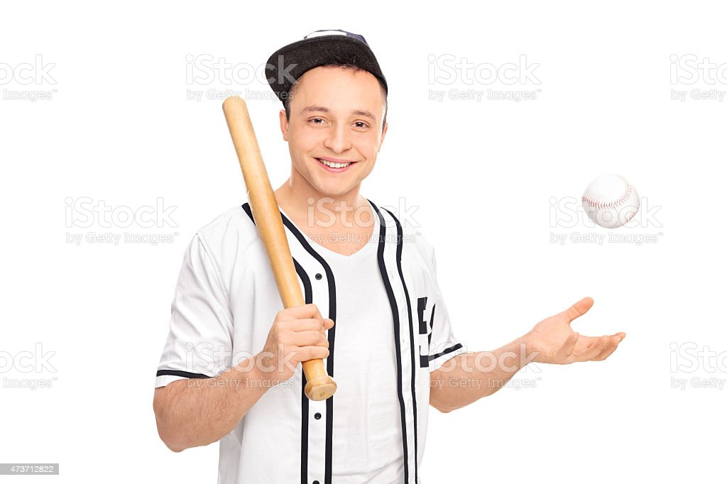 Young baseball player posing with a bat stock photo