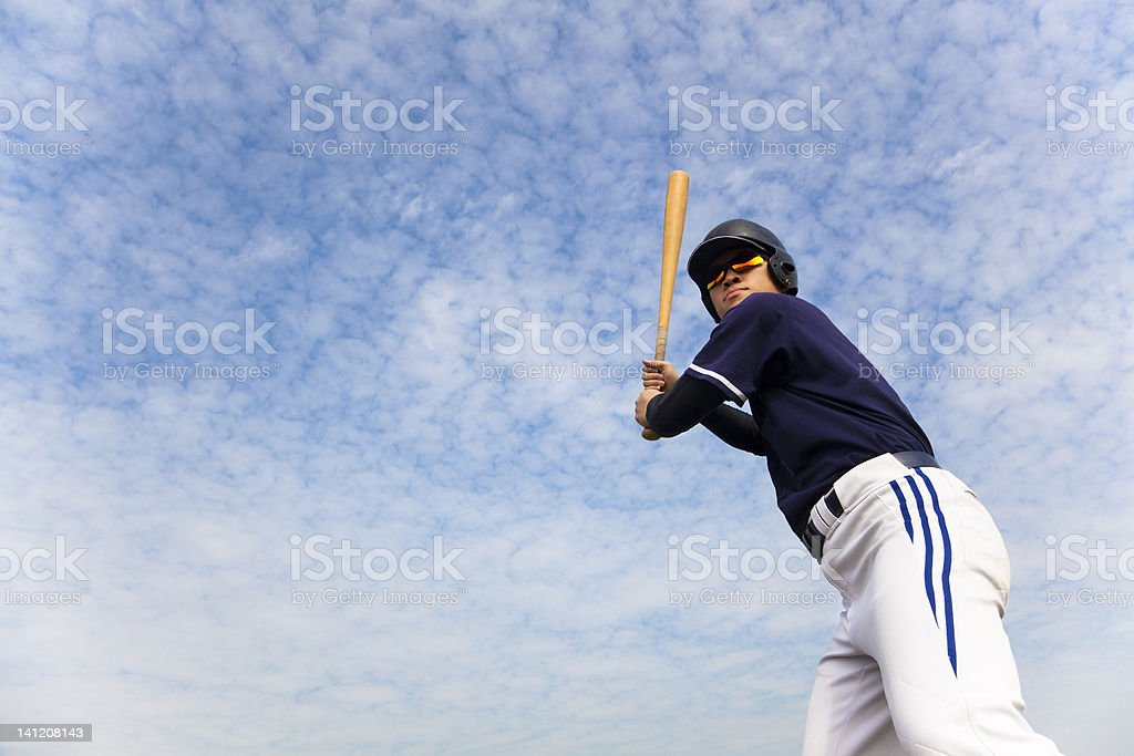 young baseball player ready for  swing stock photo