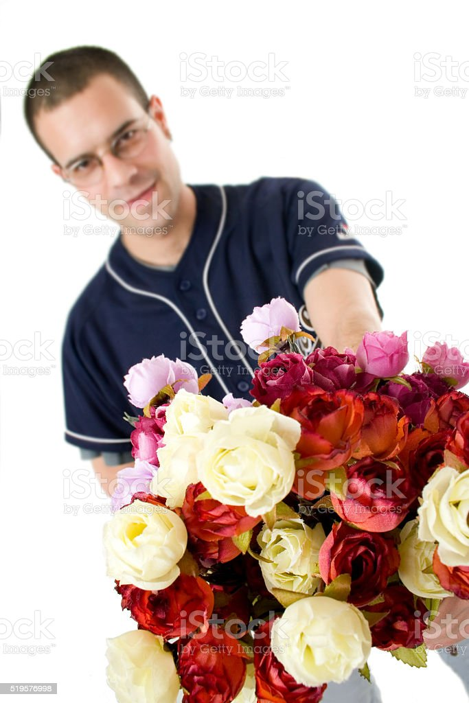 Young baseball player with bunch of fake roses stock photo