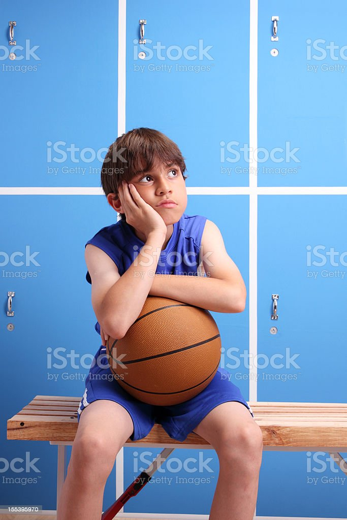 Young Basketball Alone In The Locker Room stock photo