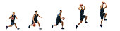 istock Young basketball player against white studio background in motion of step-to-step goal 1271104913