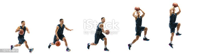 Higher. Young basketball player of team training in action, motion in jump of step-to-step goal isolated on white background. Concept of sport, movement, energy and dynamic, healthy lifestyle.