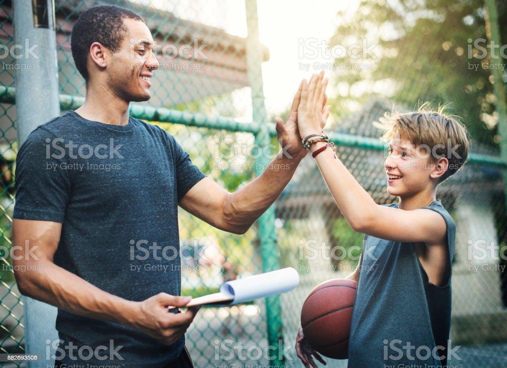 Young basketball player shoot stock photo
