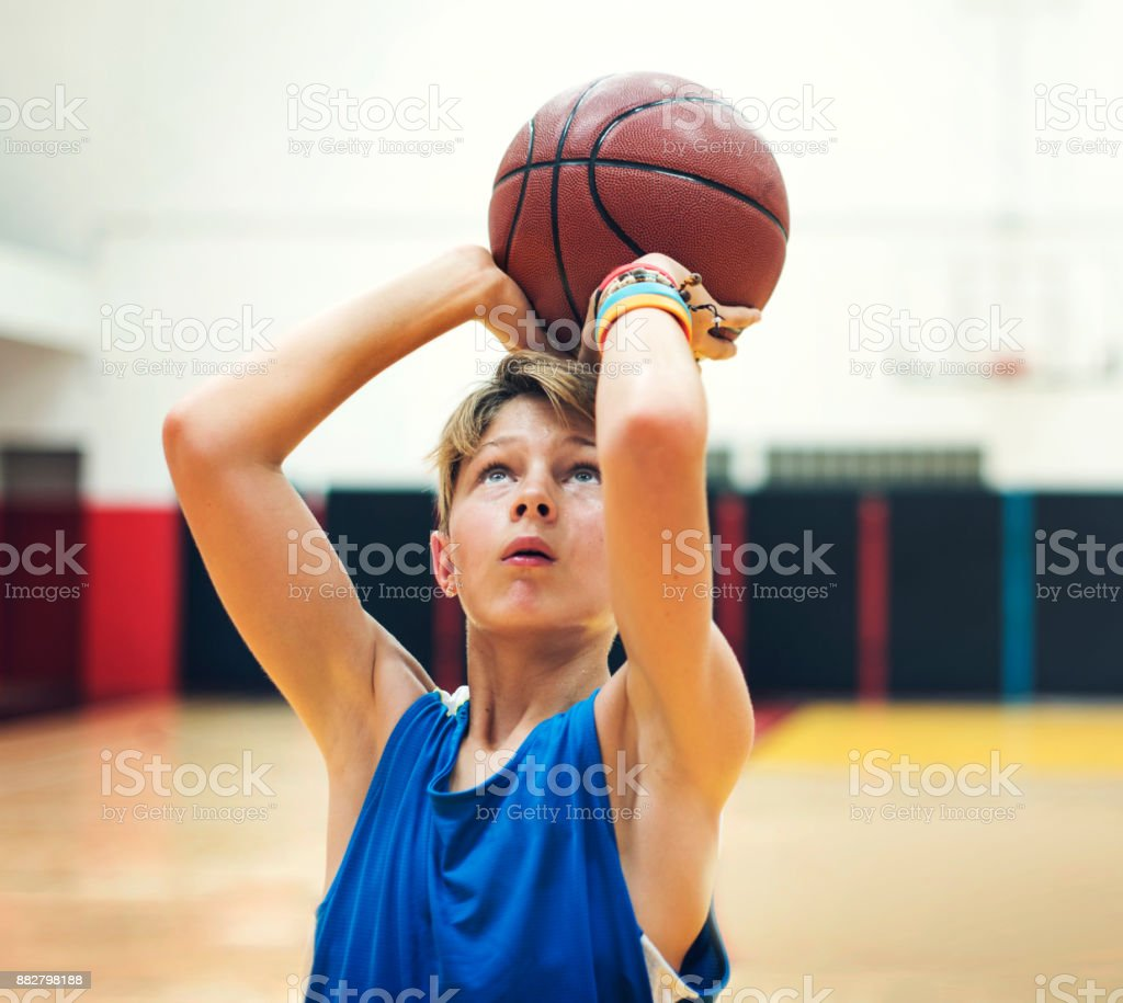 Young basketball player shoot stock photo
