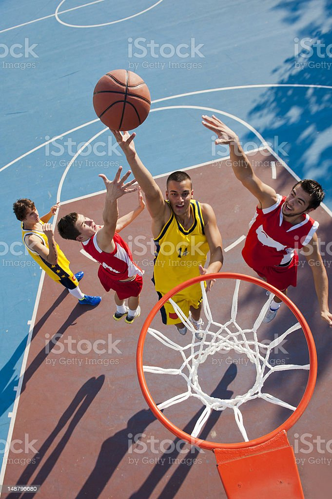 Young basketball players in the shooting action stock photo