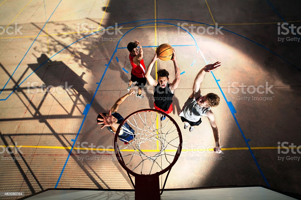 young basketball players playing with energy stock photo