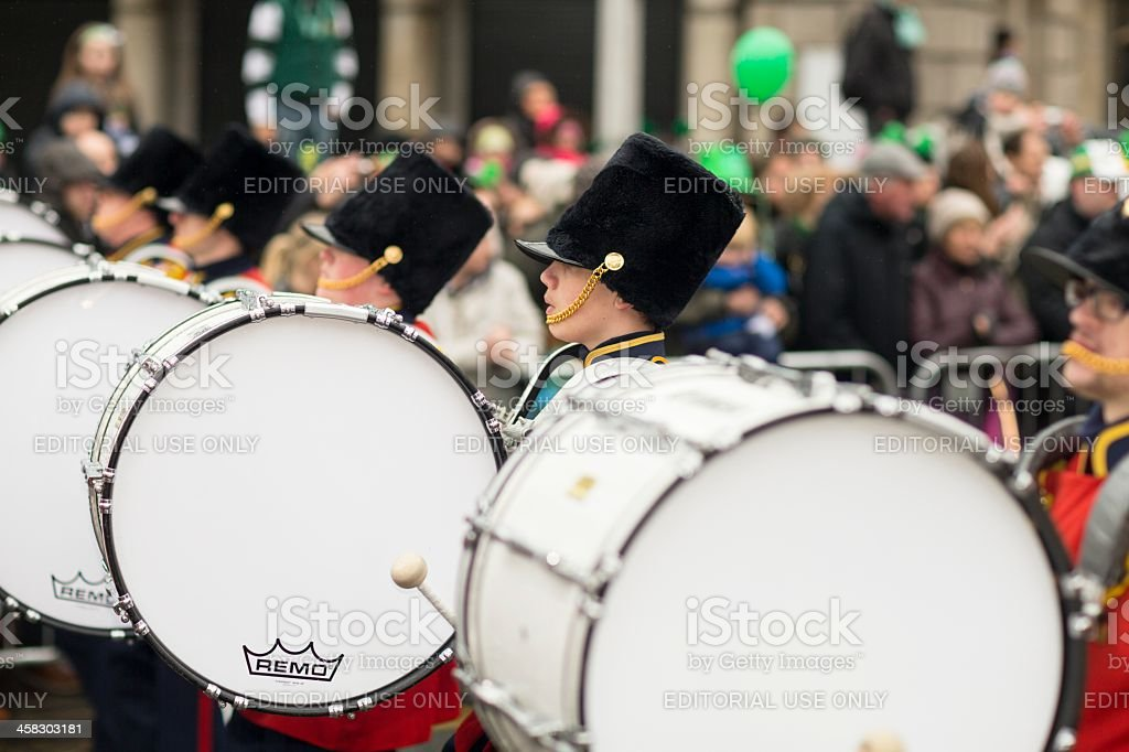 young bass drummers in one row marching stock photo