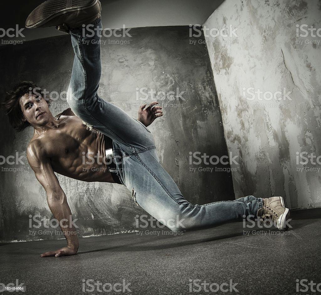 Young b-boy man doing brake dancing movements royalty-free stock photo