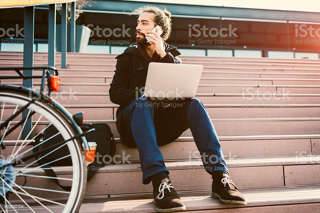 Young Beard Businessman Using Smart Phone. stock photo