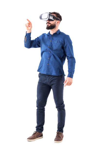 young bearded business man wearing virtual reality using finger on augmented reality touch screen - virtual reality stock pictures, royalty-free photos & images