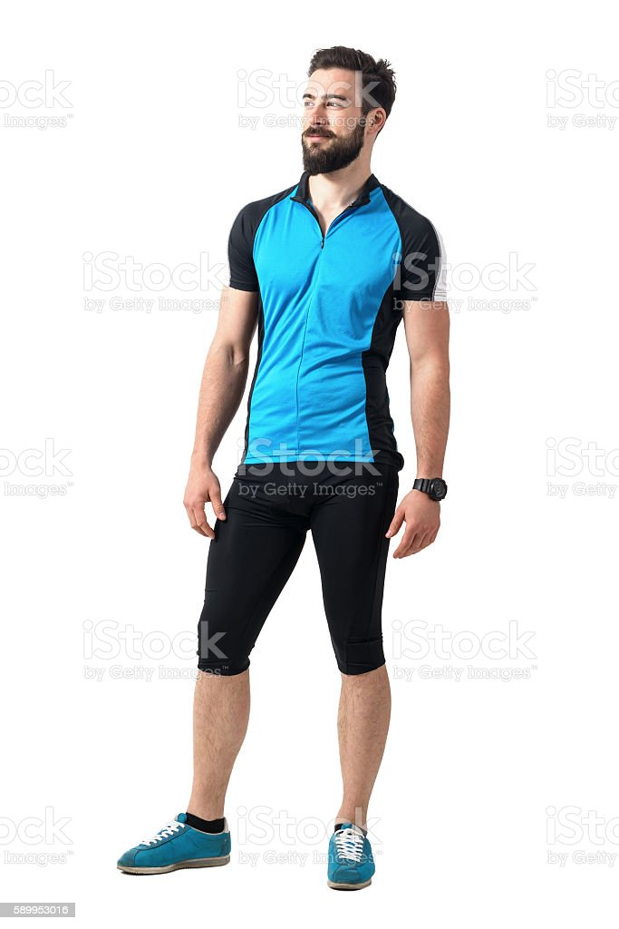 Young bearded cyclist in blue jersey t-shirt and leggings relaxed stock photo