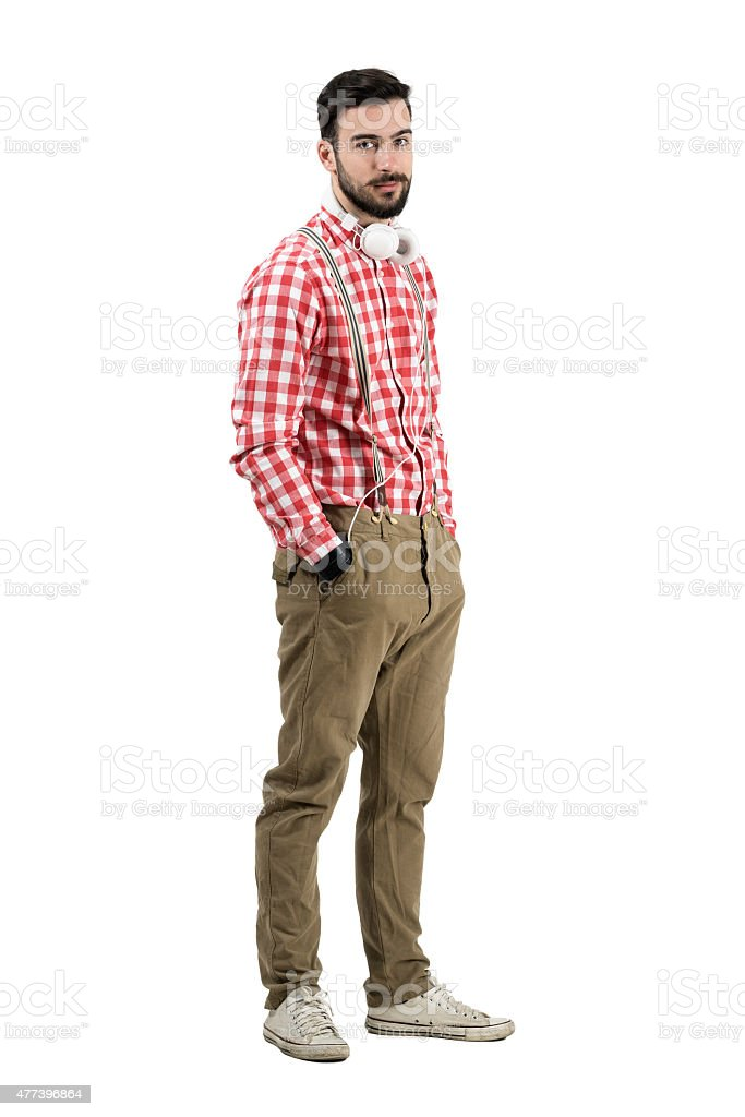 Young bearded dj in retro clothes looking at camera stock photo