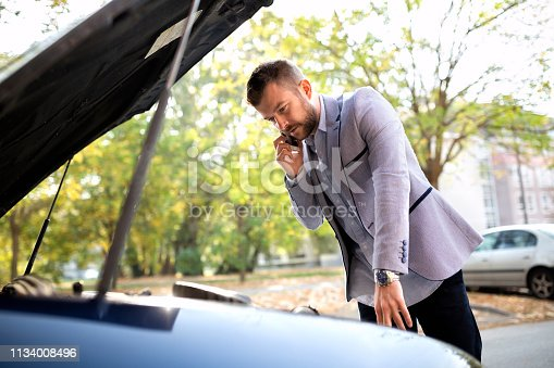 860373412 istock photo Young bearded guy having a nightmare with his car 1134008496