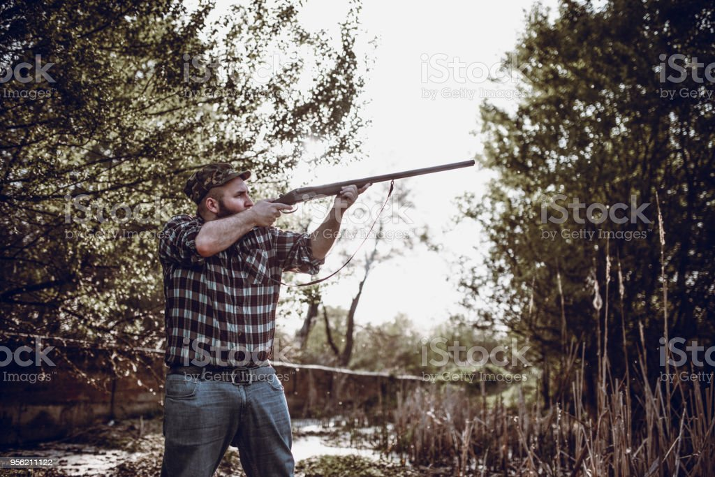 8442d9d0994 Young Bearded Hunter Shooting With Rifle Stock Photo   More Pictures ...