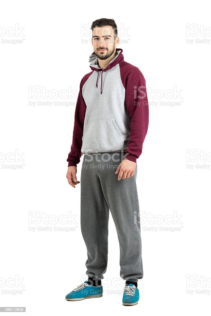 Young bearded male in sport casual clothes looking at camera stock photo