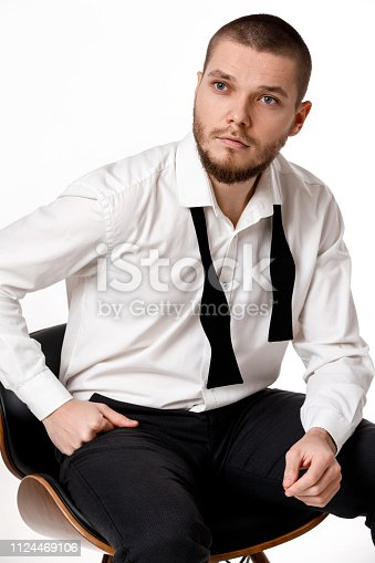 istock young bearded man in a white shirt and bow tie 1124469106