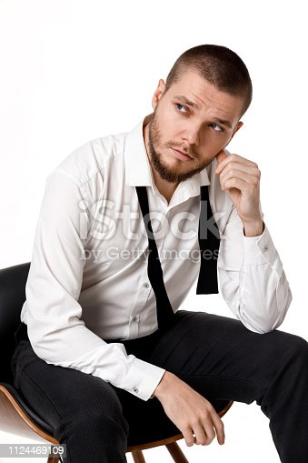 471947536 istock photo young bearded man in a white shirt and bow tie 1124469109