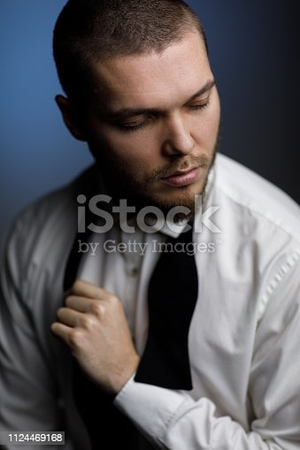 471947536 istock photo young bearded man in a white shirt and bow tie 1124469168