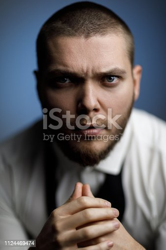 471947536 istock photo young bearded man in a white shirt and bow tie 1124469474