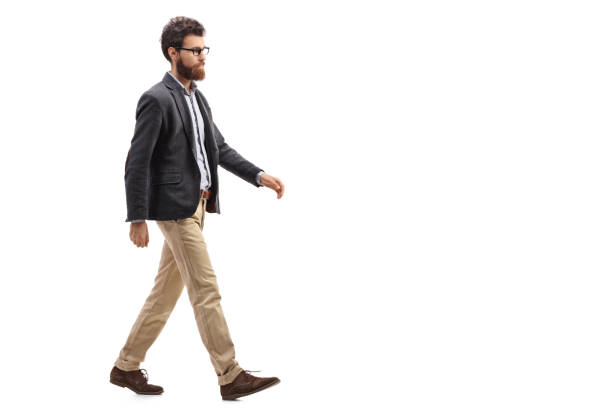 Young bearded man walking stock photo