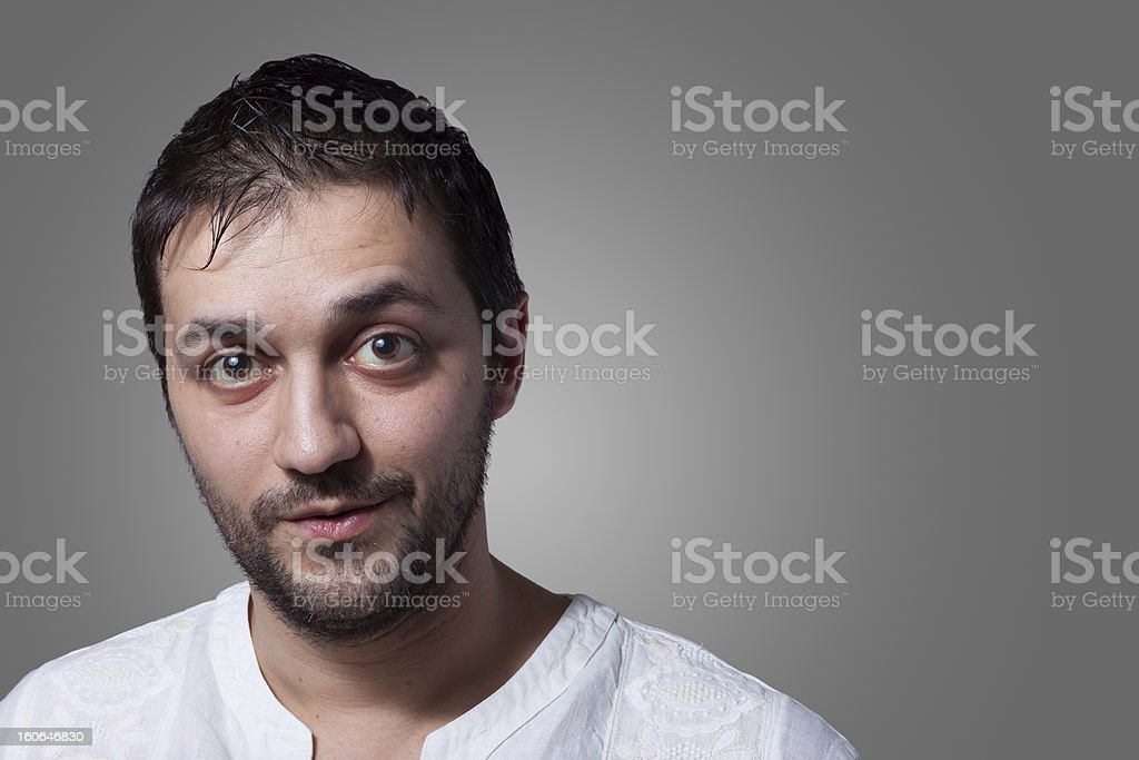 Young bearded man with a little smile stock photo
