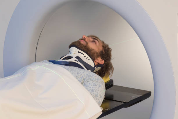 Young Bearded Man With a Neck Brace Receiving a Medical Scan stock photo