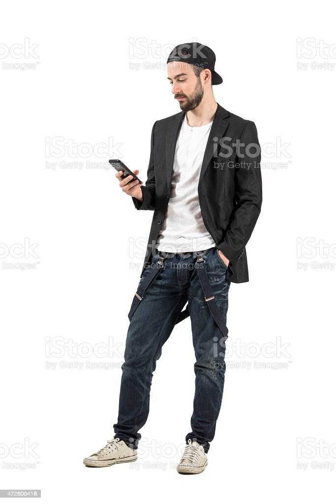 Young bearded man with backward hat using mobile phone device stock photo