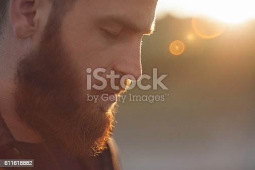 istock young bearded man with eyes closed 611618882